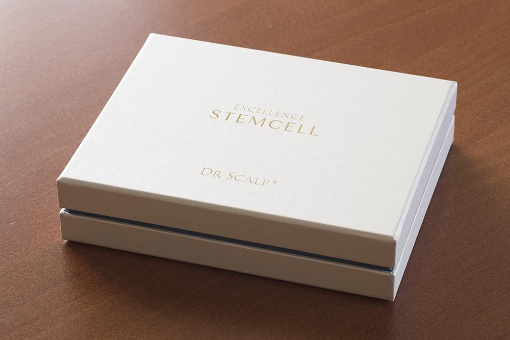 商品の企画開発から関わった育毛美容液パッケージ(インロー式スリット入)化粧箱、貼箱